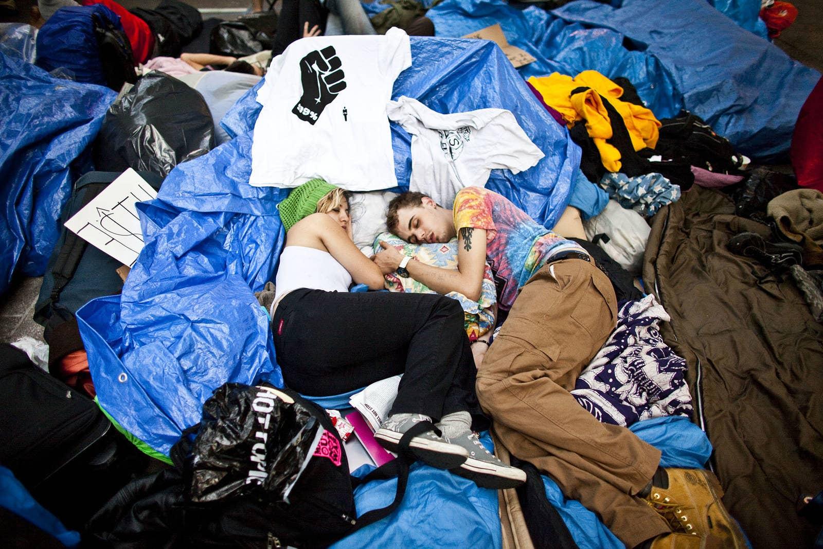 A couple sleeps at the Zuccotti Park encampment on Oct. 8, 2011.