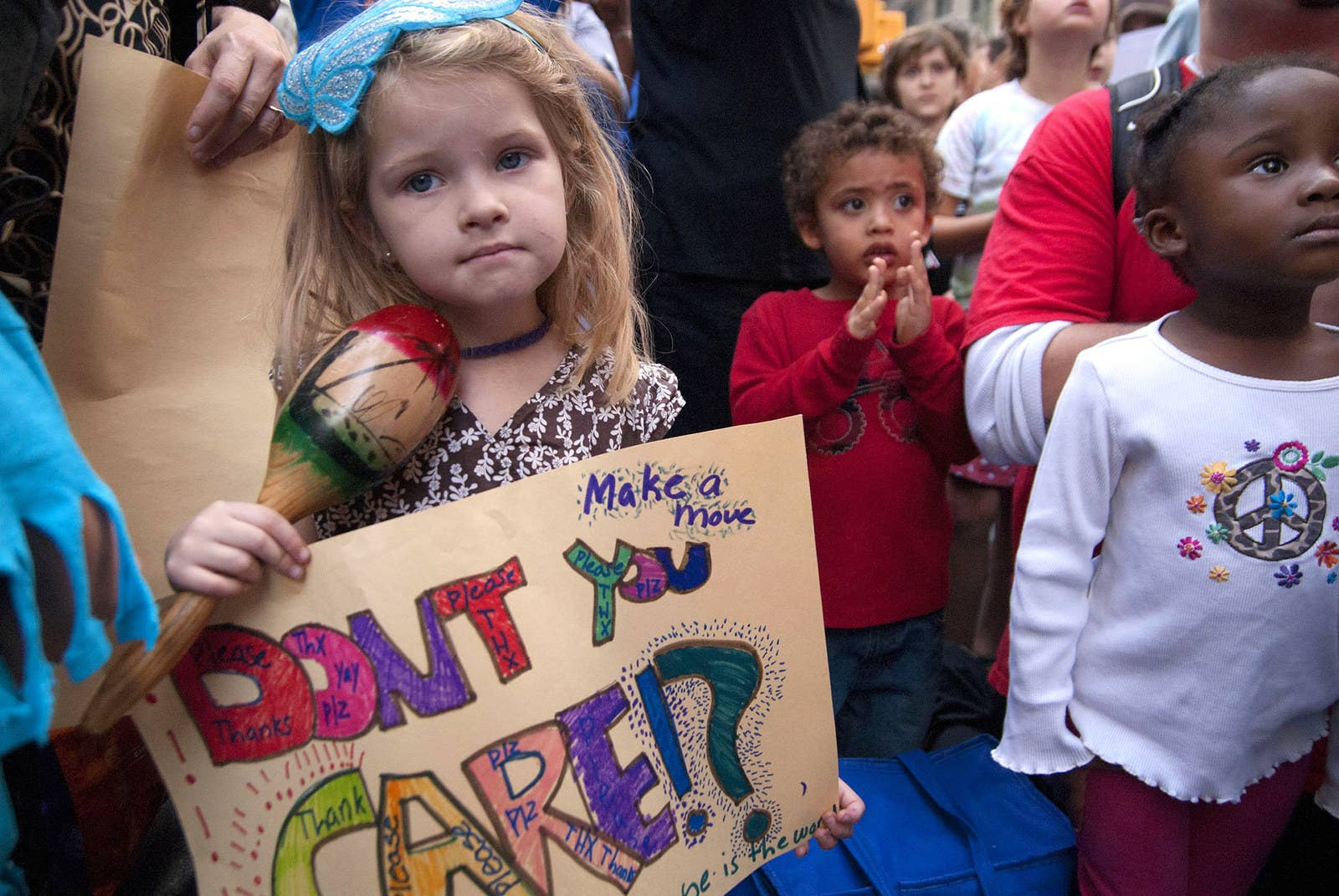 Schoolchildren attend an Occupy Wall Street protest with their parents in Zuccotti Park on Oct. 10, 2011.
