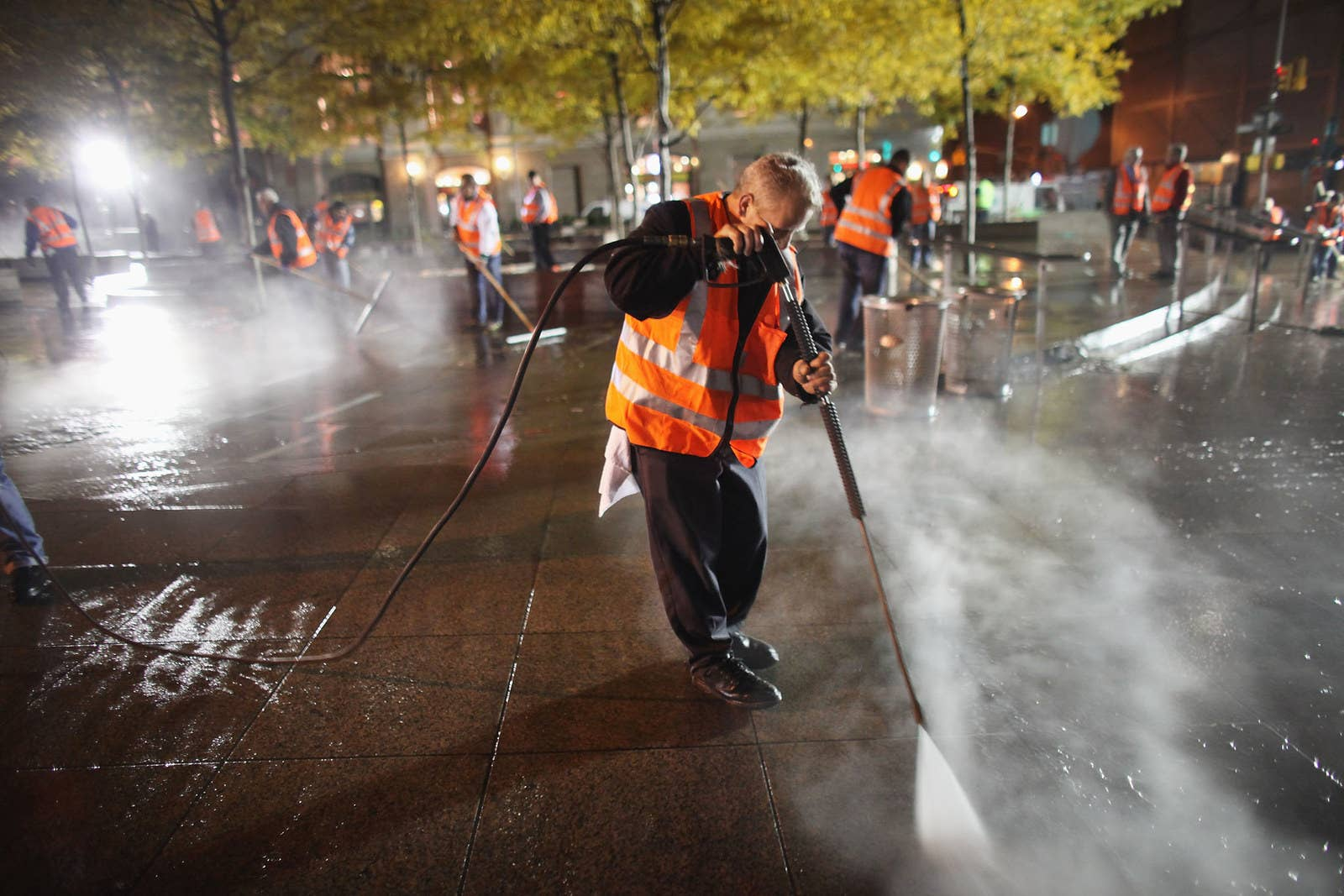 Workers clean up Zuccotti Park after New York City police in riot gear removed Occupy Wall Street protesters early on Nov. 15, 2011.