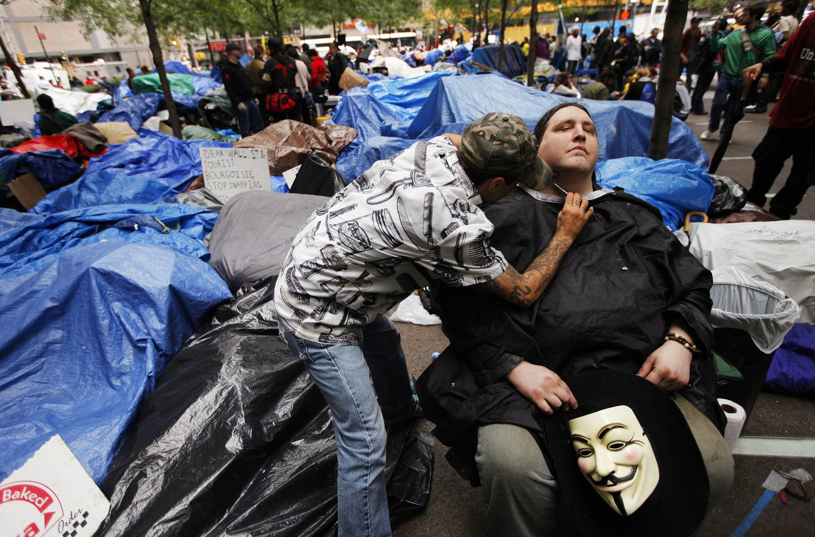 A member of the Occupy Wall Street movement gets a shave in Zuccotti Park on Oct. 12, 2011.