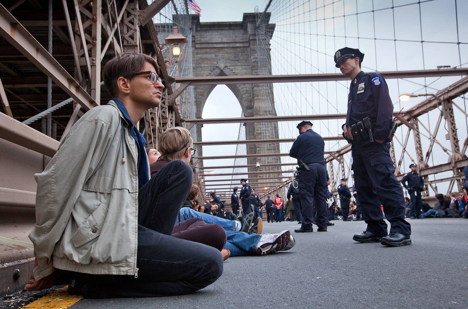 Detained protesters are forced to sit on both sides of the Brooklyn Bridge while waiting to be taken to jail on Oct. 1, 2011.
