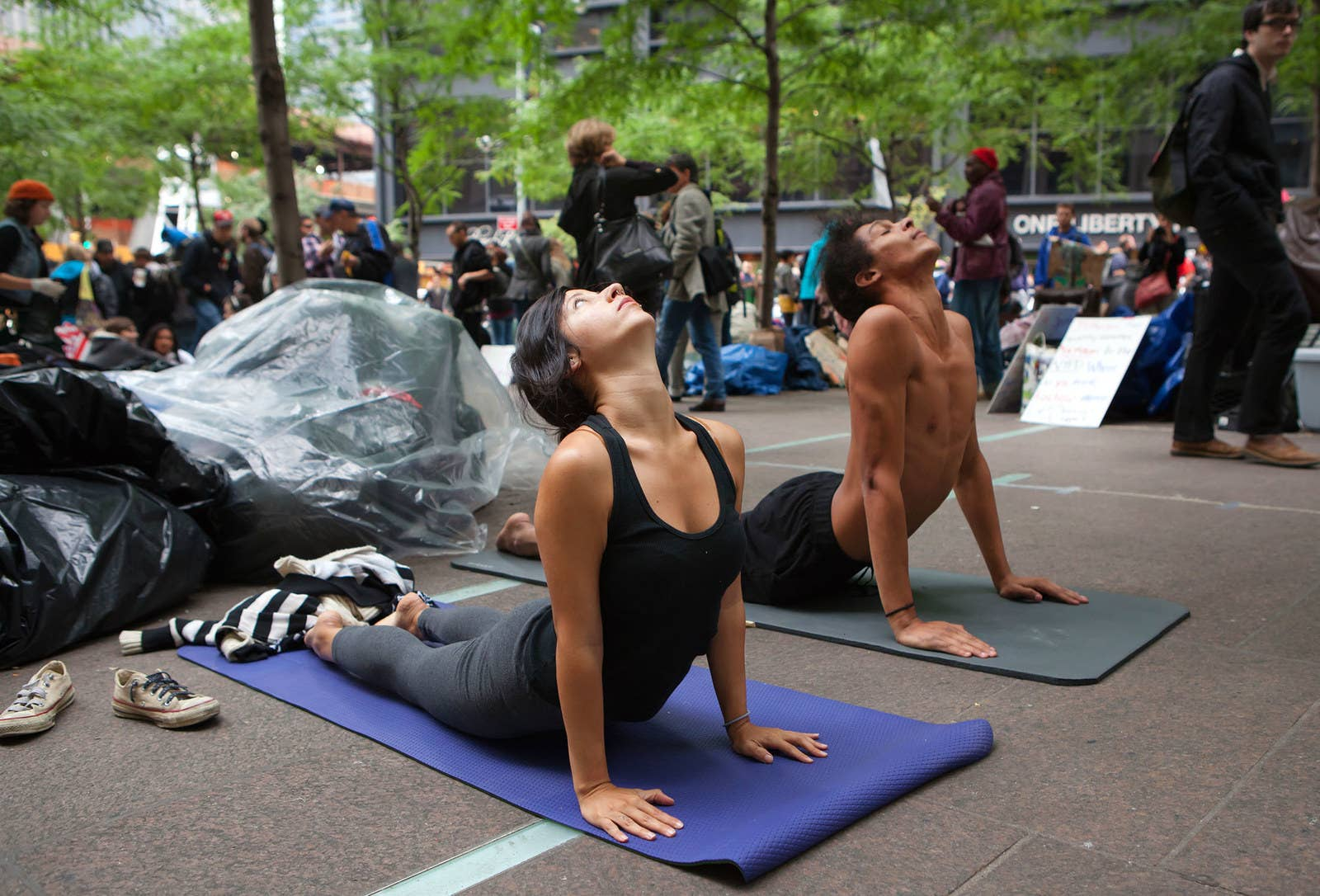 Jamie Pumello and Elijah Moses practice yoga in Zuccotti Park on Oct. 3, 2011.