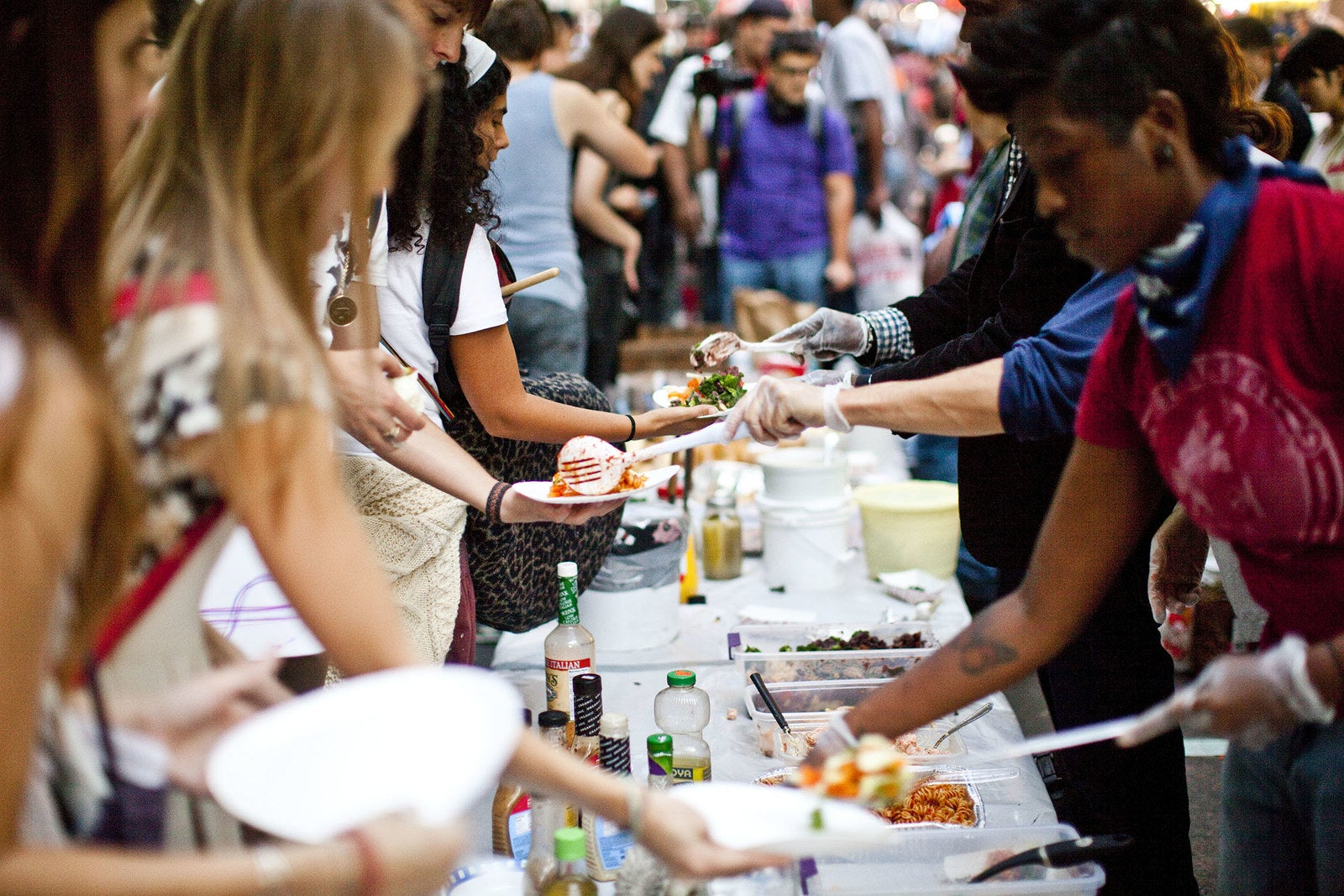 Volunteers serve food to protesters at Zuccotti Park on Oct. 8, 2011.