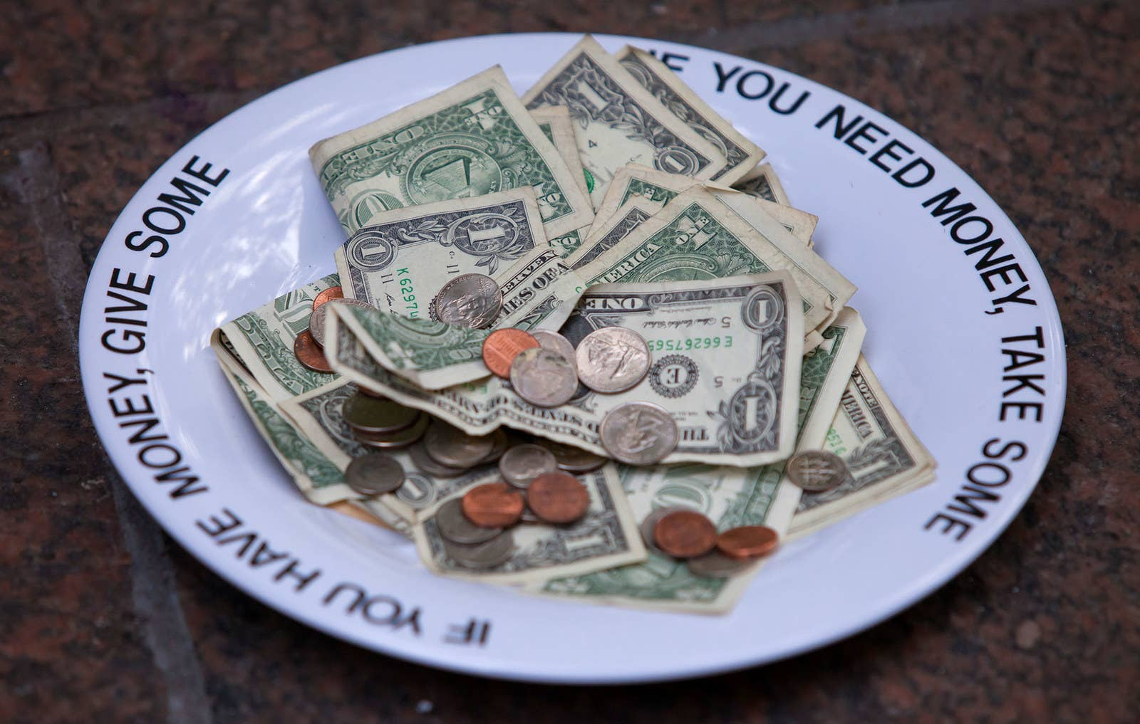 A donation plate of money is left for whoever needs it in Zuccotti Park on Sept. 27, 2011.