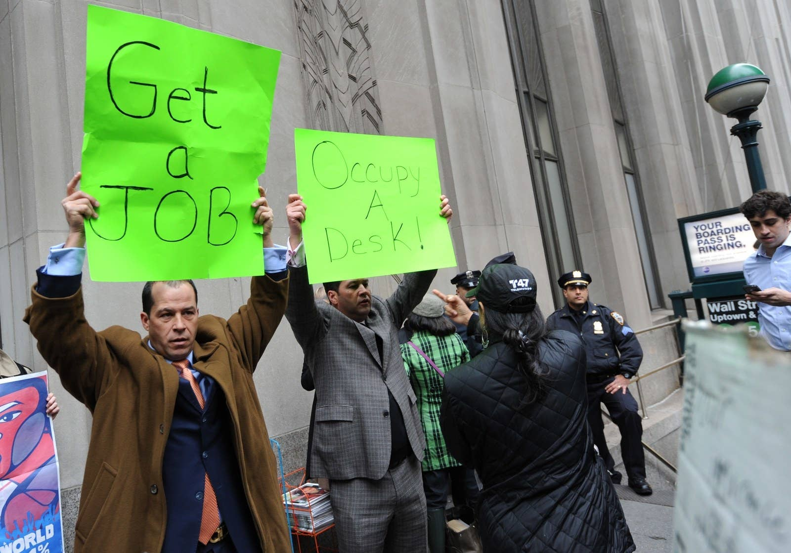 A pair of businessmen demonstrate against the Occupy Wall Street march near the New York Stock Exchange on Nov. 17, 2011.
