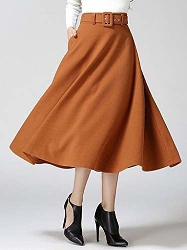 model wearing burn orange midi skirt with black ankle boots
