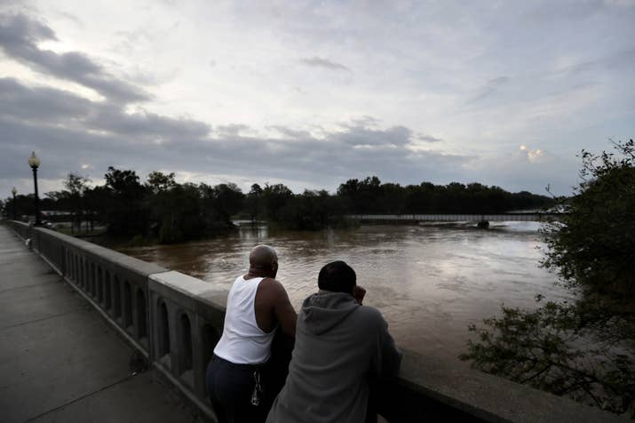 Residents observe the Cape Fear River as it continues to rise in Fayetteville, North Carolina.