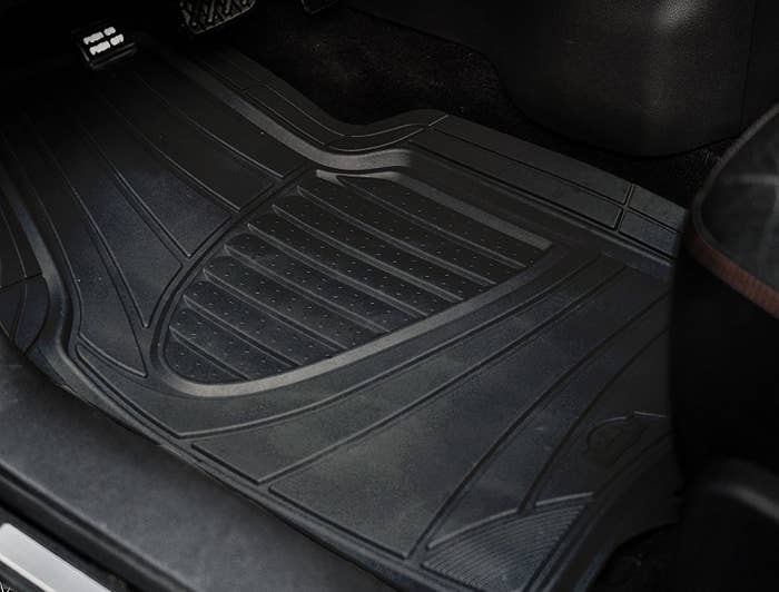 The mats on the floor of a car