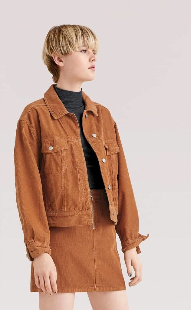 """Promising review: """"This jacket is a super cute cut. It is not too short and hits right above the hips. It's cute and boxy and not too oversize. The material is strong and thick and looks like it will last for many years. The color is more burnt in person, which is more attractive than an orange color. SUPER cute jacket."""" —MeghmPrice: $90 (available in sizes 2–12)"""