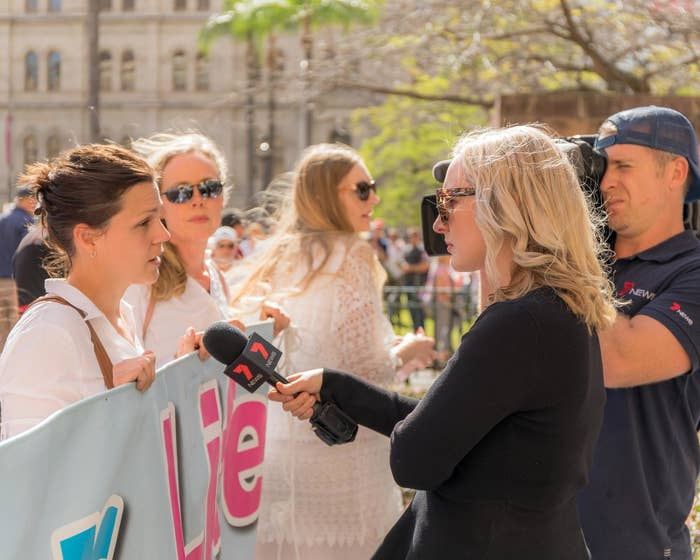 Alexandra Doig speaking with reporters at a pro-life rally in Brisbane.