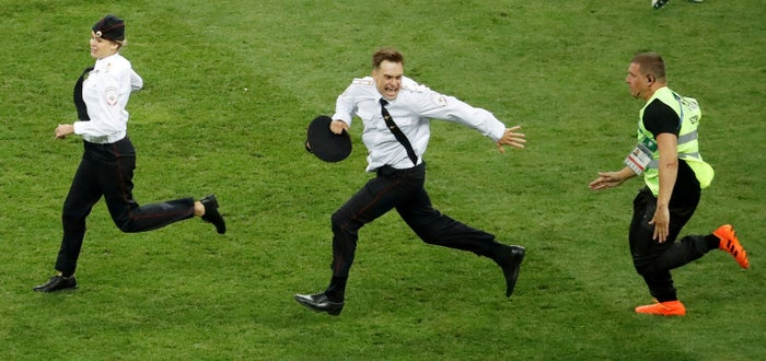 Pyotr Verzilov (centre) staging a pitch invasion during the World Cup Final on July 15.