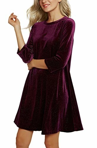 model wearing shorter burgundy quarter sleeve swing dress