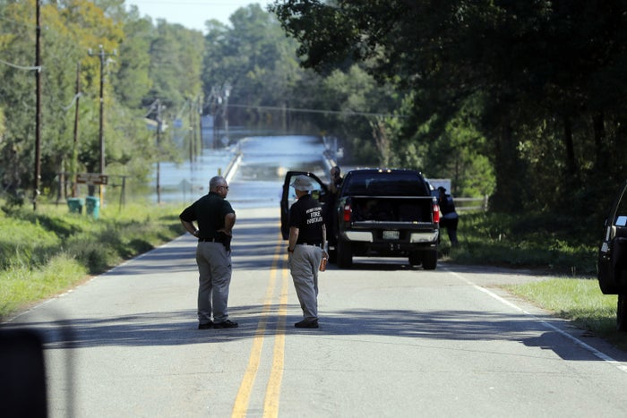 Responders congregate Wednesday near where two people drowned Tuesday evening when they were trapped in a Horry County Sheriff transport van.