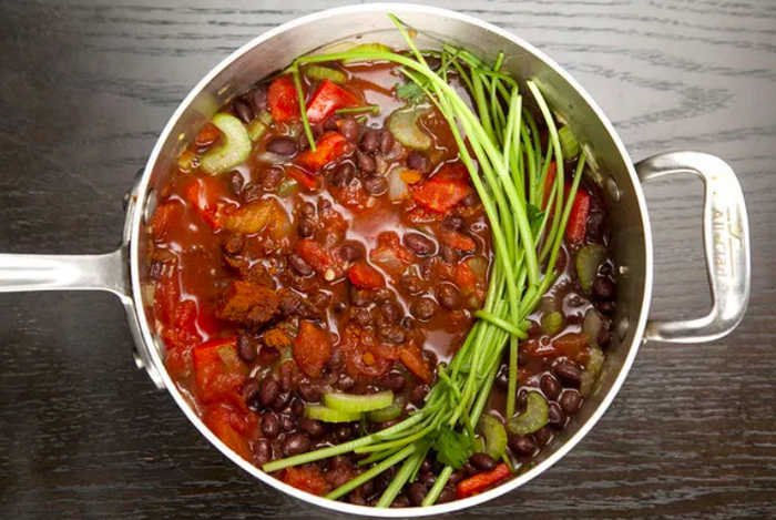 If you're planning on simmering a stew or soup for a long time, add some leftover herbs. They'll add layer and complexity to the flavor. More here.