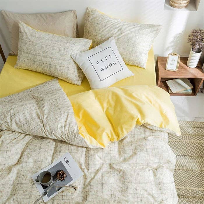 the yellow and beige duvet set with a pillow that reads feel good