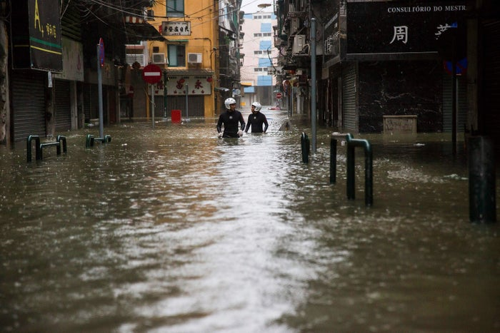 Rescue workers make their way through floodwaters during Typhoon Mangkhut in Macau on Sept. 16.
