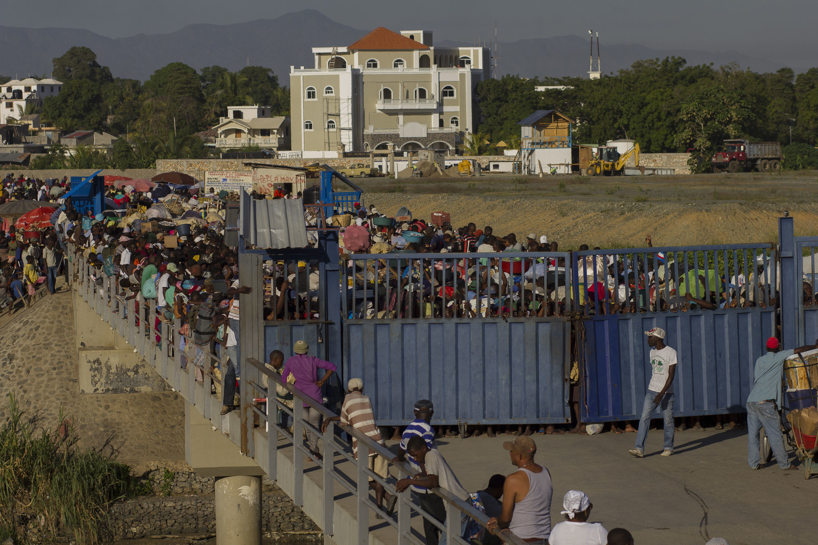 Haitians waiting to cross the Massacre River to the border town of Dajabón to purchase food.