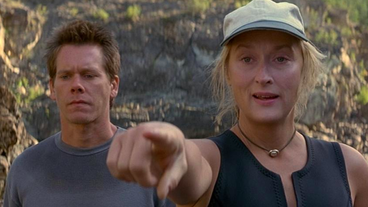 """When THE Meryl Streep tells you she's tired, maybe listen? While shooting this film, Streep — who did many of her own stunts — was told to do ONE MORE take by the director on a very rough river, which nearly cost her her life. """"The boat surfed down into the hole, rose and flipped over, and I went into the river. I remember sinking down to the bottom with this powerful and freezing water pulling me in deeper,"""" Streep said. """"My first thought was that if I died, my husband would come to the set with a machete."""""""