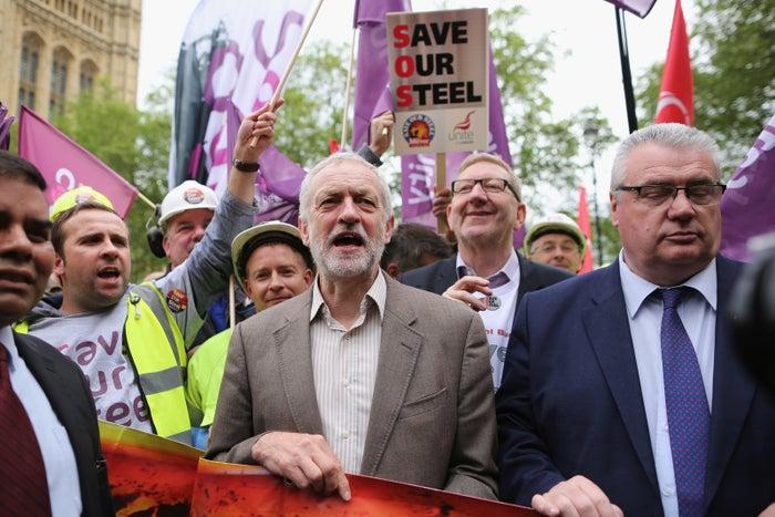Jeremy Corbyn protests alongside union figures, including Len McCluskey.