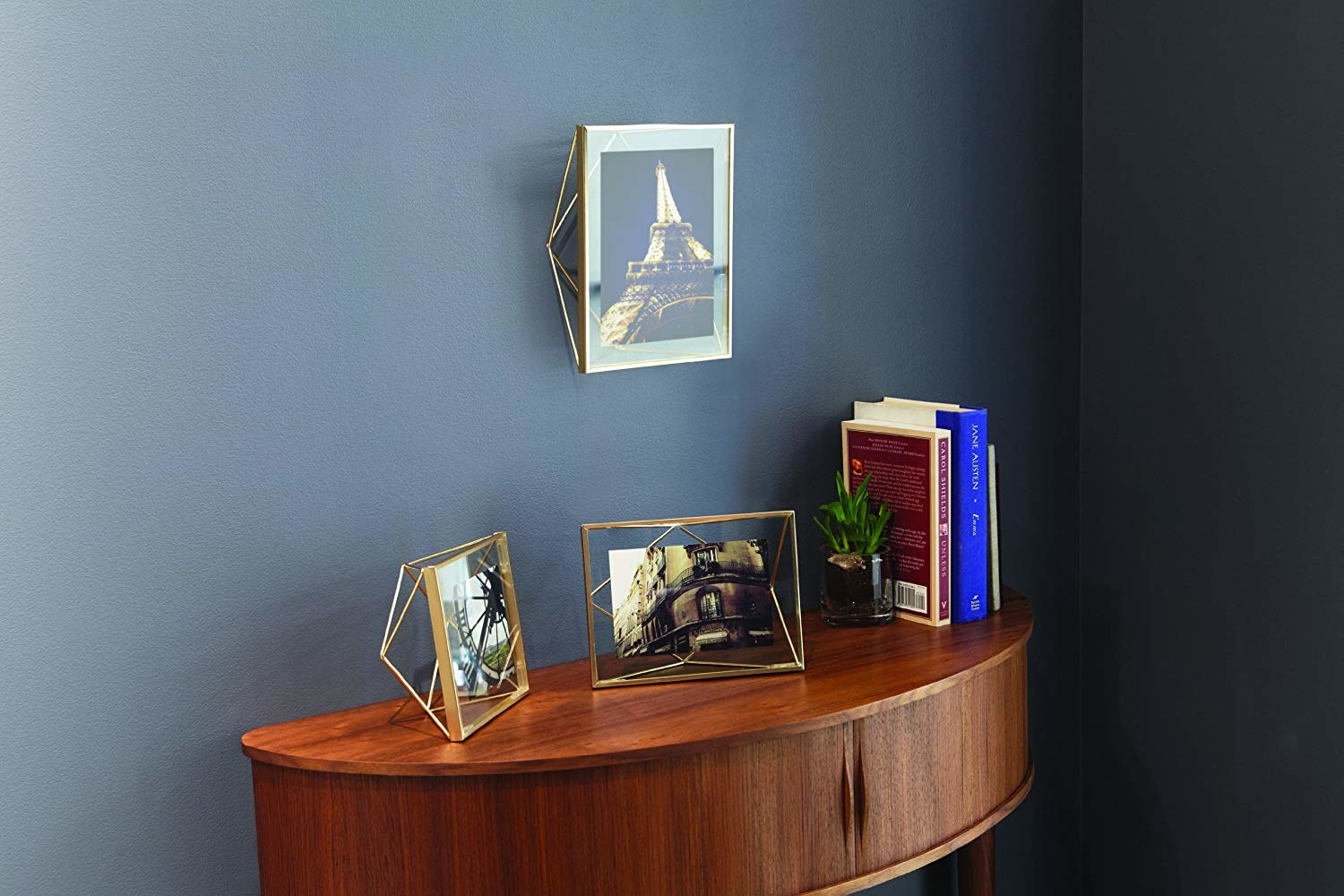 a reviewer showcasing the frame on their wall and table
