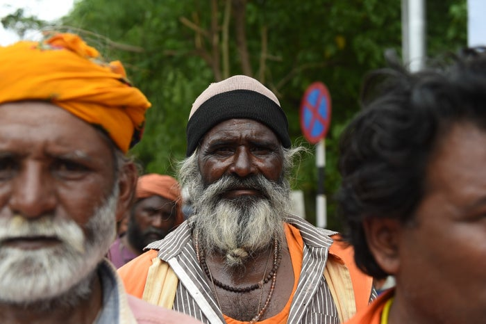 Members of India's Vaadi community participate in a protest in support of Shantadevi Nath, who was killed by a mob who falsely believed she was intent on abducting children in July.