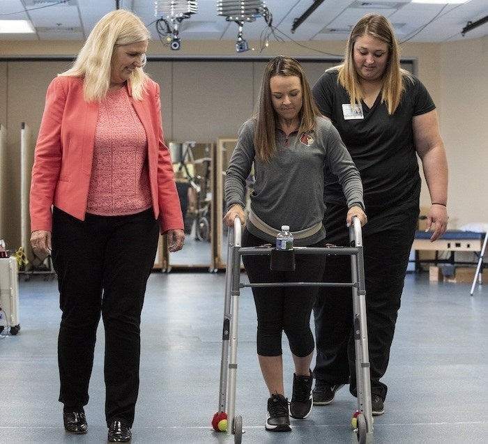 Susan Harkema, PhD, (left) with research participant Kelly Thomas and trainer Katie Pfost