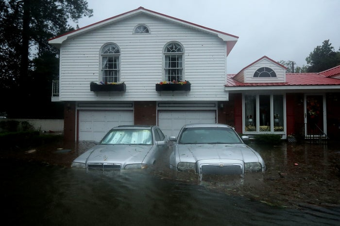 Homes are inundated after a storm surge from Hurricane Florence flooded the Neuse River, Sept. 14, 2018, in New Bern, North Carolina.