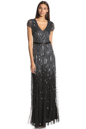 89800820155b An embellished cap sleeve dress that looks as if it just walked off the set  of The Great Gatsby. Daisy Buchanan, does this happen to be yours?