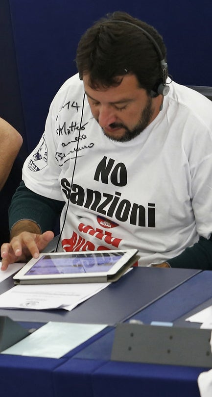 "Matteo Salvini pictured in 2014, when he was a member of the European Parliament, wearing a T-shirt with the words ""No to sanctions to Russia"" written in Italian."