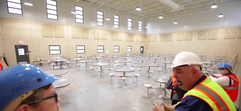 The open space pictured below is where the prison holds contact visits, when inmates are allowed to embrace their visitors.The rooms with the gray doors on the left are where inmates can have no-contact visits, speaking via telephones to visitors who are divided by a glass wall.