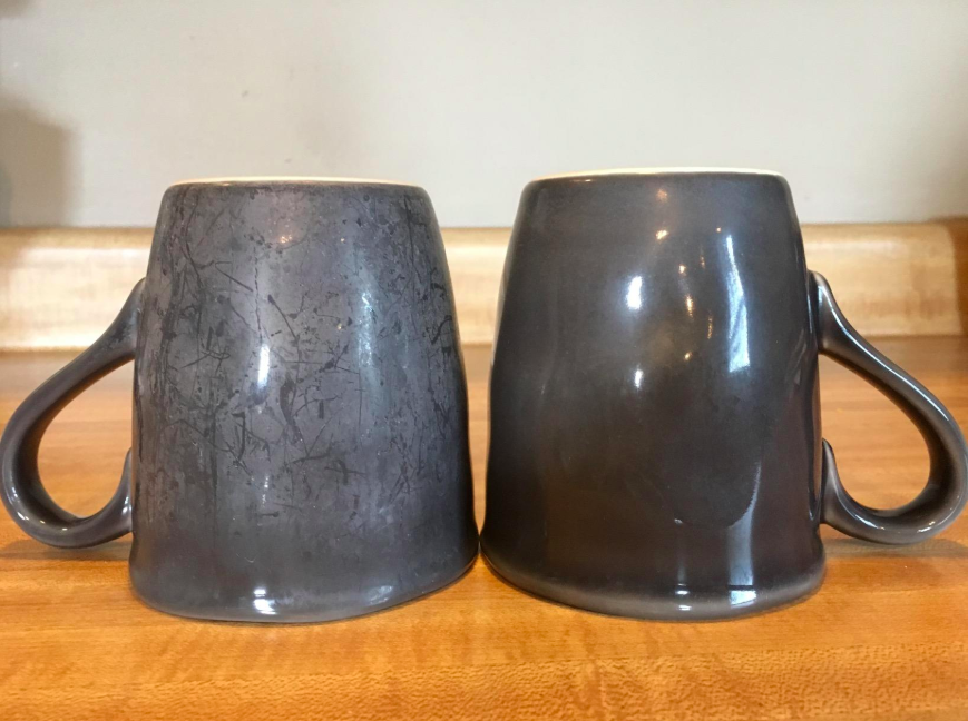 reviewer photo of stained mug next to a clean mug after using powder