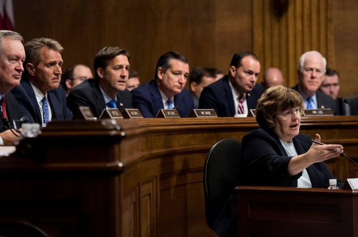 """Pictured behind Mitchell (from left) are Sens. Mike Crapo, Jeff Flake, Ben Sasse, Ted Cruz, Mike Lee, and John Cornyn. (The other Republican members not pictured are Sens. John Kennedy, Thom Tillis, Lindsey Graham, Orrin Hatch, and chair Chuck Grassley.)In sharing the photo, some people made reference to McConnell's """"female assistant"""" comments."""