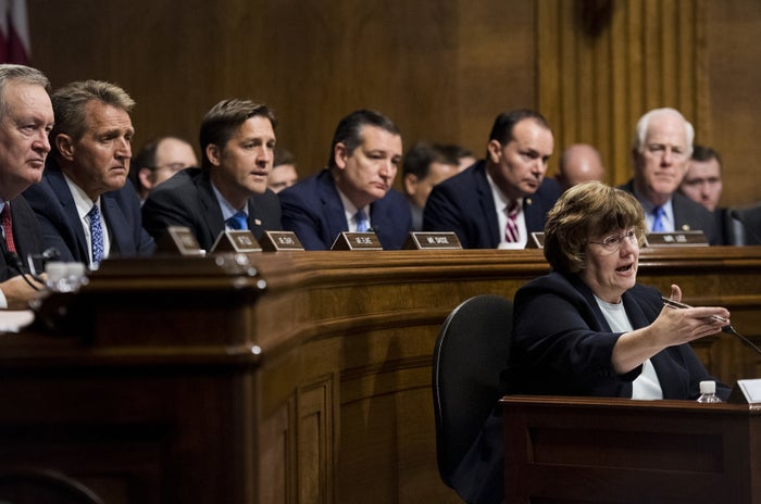 Phoenix prosecutor Rachel Mitchell questions Christine Blasey Ford as Sens. (from left) Mike Crapo, Jeff Flake, Ben Sasse, Ted Cruz, Mike Lee, and John Cornyn, listen during the Senate Judiciary Committee hearing on Sept. 27, in Washington, DC.
