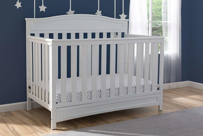 """This converts to a toddler bed, daybed, and full-size bed (daybed rail is included while the toddler guardrail and full-size metal bed frame are sold separately). It fits a standard size crib mattress.Promising review: """"I LOVE LOVE LOVE this crib. It's so cute, I put it together by myself (pregnant) in under an hour. The directions are easy to follow, and the hardware is delivered in a way that makes the process a breeze. I am so excited for our little one to enjoy it as much as I am (already!)"""" —SarBearPrice: $189.99 (available in white, brown, and gray)"""