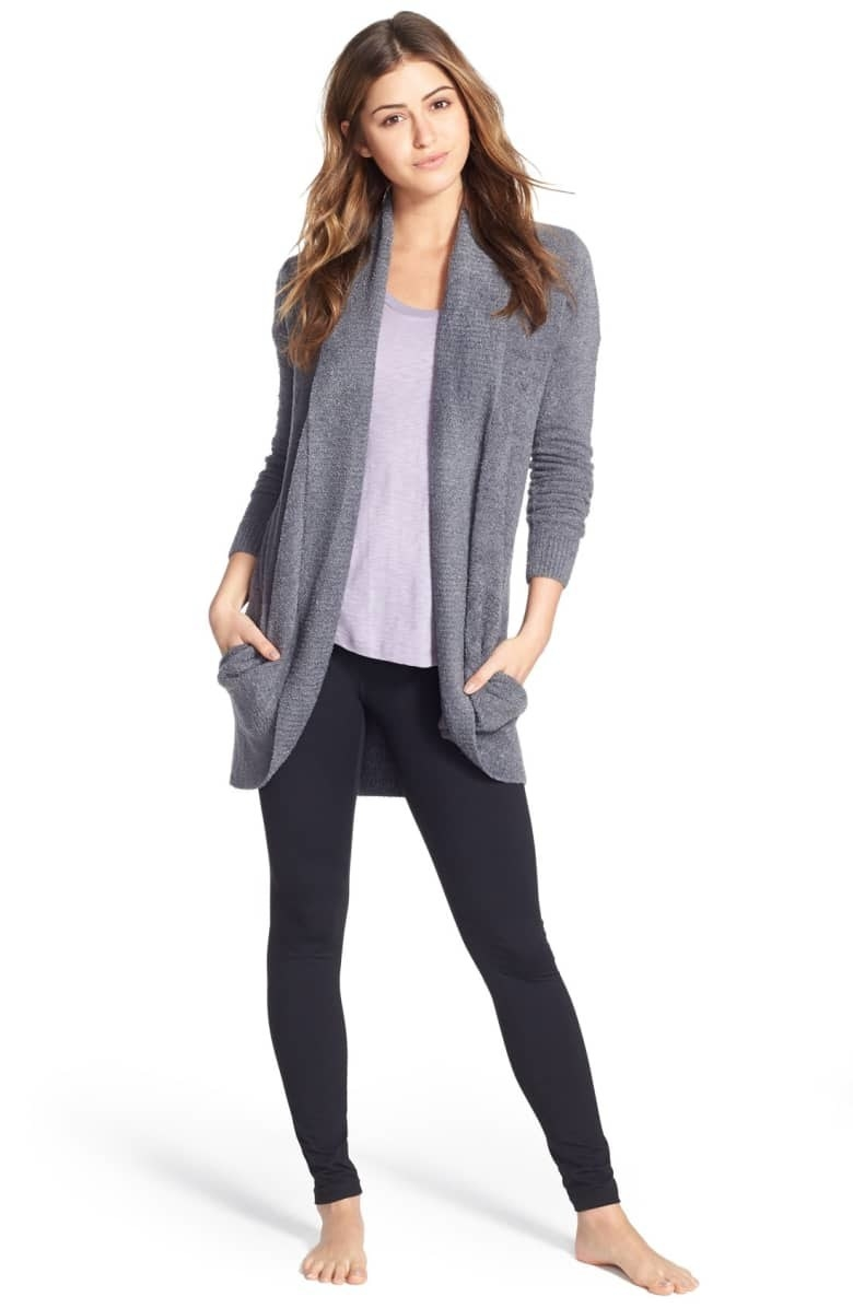 A model wearing the cardigan in Pacific Blue with leggings