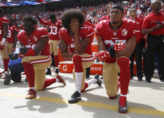 From left, San Francisco 49ers Eli Harold (58), quarterback Colin Kaepernick (7) and Eric Reid (35) kneel during the national anthem before their NFL game against the Dallas Cowboys on Sunday, Oct. 2, 2016, at Levi's Stadium in Santa Clara, California.