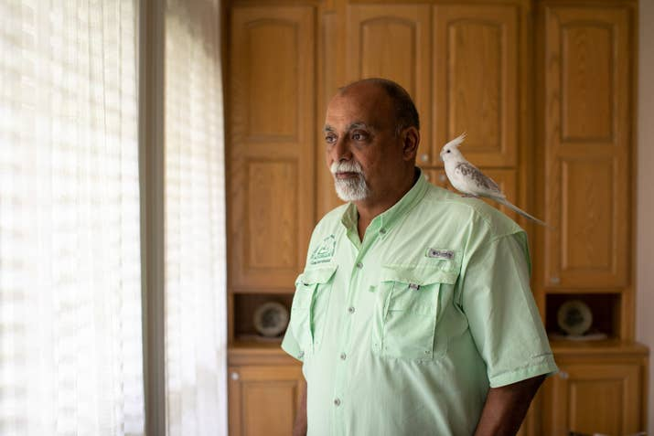 Khalifa with his cockatiel Snow at his home in Tyler, Texas.