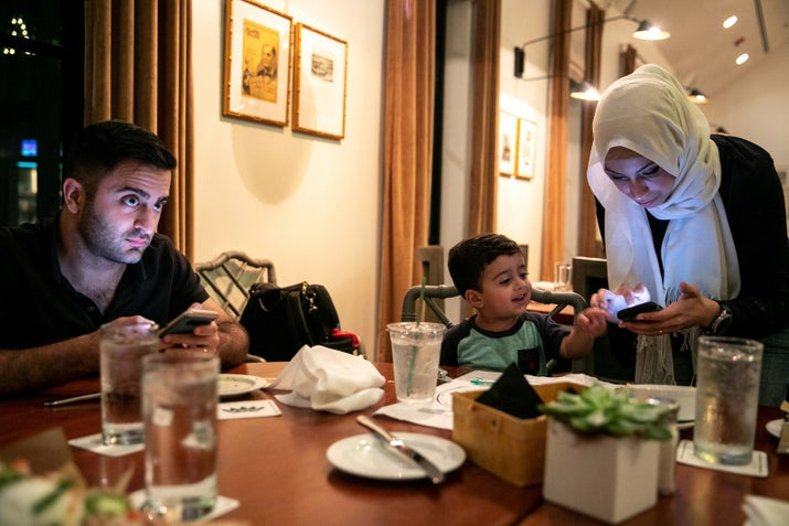 Mohammad Arif and Fatima Elkabti dine out with their son, Zakaria, in Tyler.