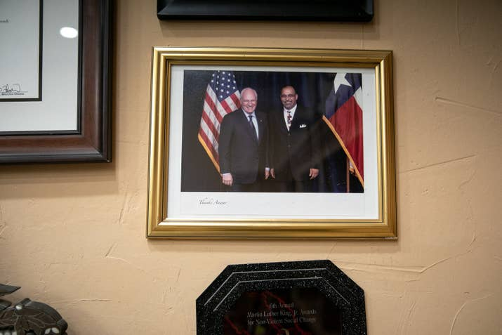 A photo of Khalifa with the former vice president, Dick Cheney, in Khalifa's office.