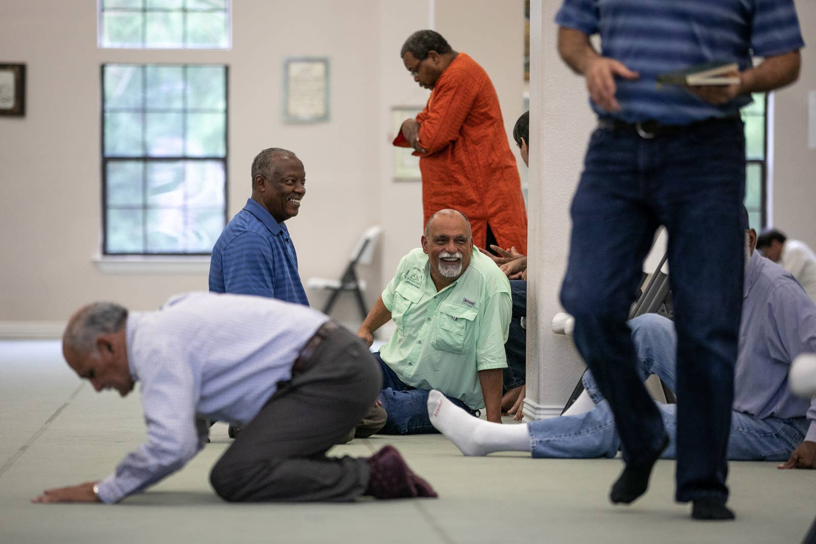 Khalifa chats with friends before Friday prayer at the East Texas Islamic Society in Tyler.