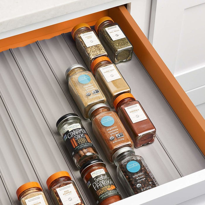 """These liners are meant to fit 24 full-size round or square spice bottles.Promising review: """"This is one of my favorite things I've ever purchased from Amazon! They are so customizable and allow you to cut them and shape them to any drawer size! I think this will be my go-to gift for all of my friends who love cooking as much as I do. Freeing up cabinet space and having something that can so easily be rinsed off in the sink makes this a for-sure buy!"""" —momononoGet a six-pack from Amazon for $12.99."""