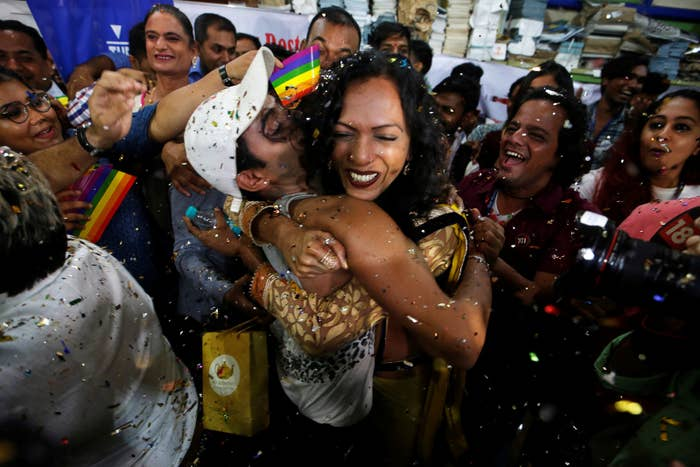 People celebrate in Mumbai after the Supreme Court decision.