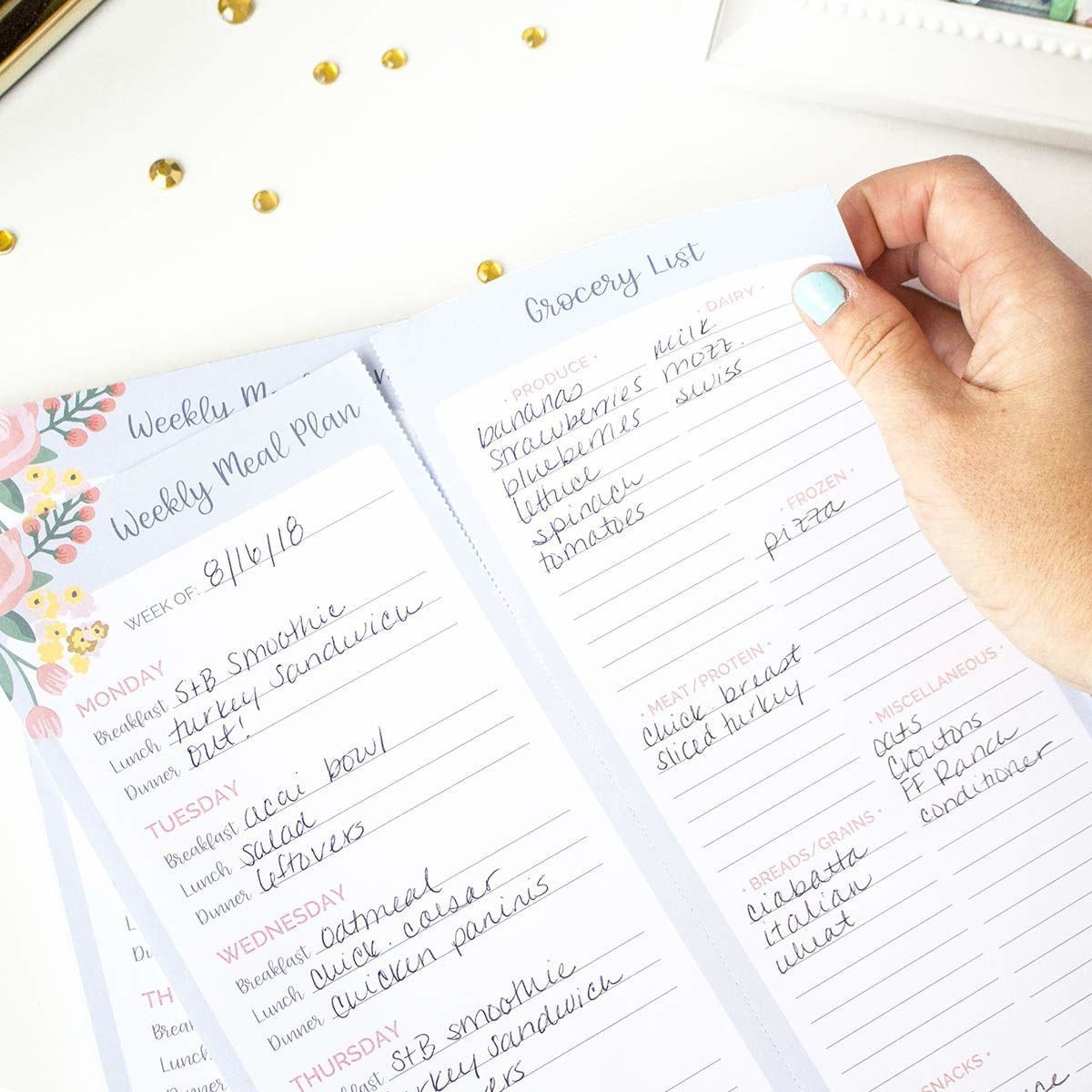 """Promising review: """"It's silly how much order a tablet of paper can bring to life. I use this to manage family schedules down to meal planning. I am usually filling multiple pages at once, but it allows me to look forward without being overwhelming. I love this product and very highly recommend it. I have even given away a few pages for friends to try!"""" —Amazon CustomerGet it from Amazon for $11.95."""