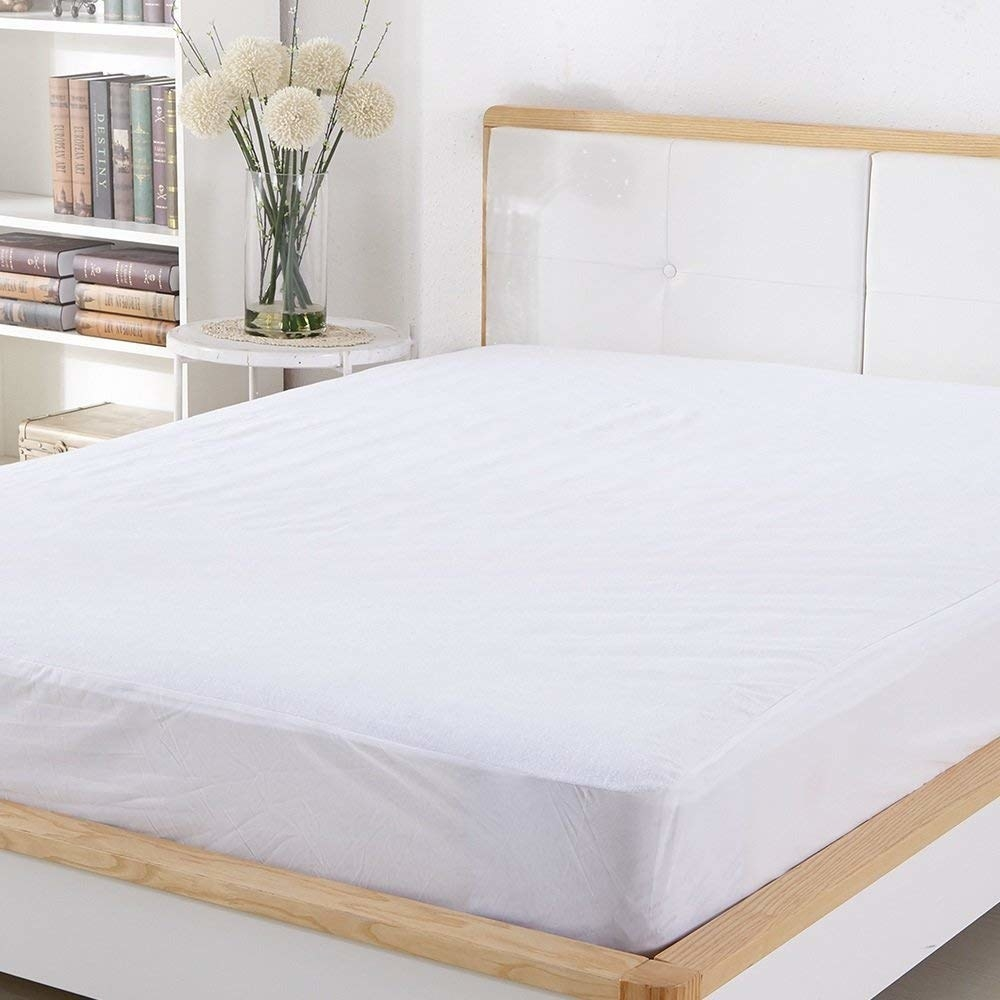 """Promising review: """"Love this thing! Spend a little money on the good stuff like this! It helped during a recent spill, and the mattress was completely untouched. The quality of this protector is AMAZING! Noiseless and beautiful."""" —NancyGet it from Amazon for $15.99+ (available in three sizes)."""