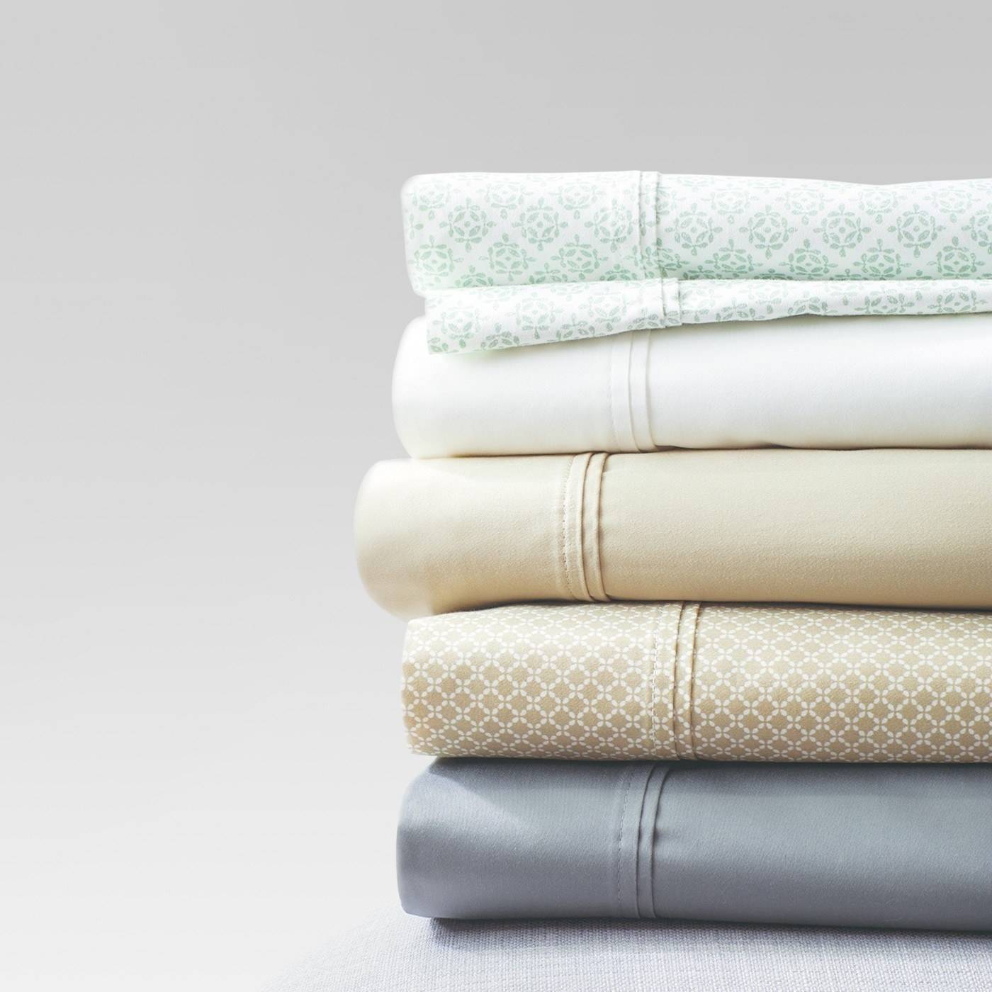 """Each set includes one flat sheet, one fitted sheet, and two pillowcases. Read a Angle Newser's full review of these Target sheets. Promising review: """"I like a cotton sheet, but it has to feel silky. I don't want to slip into bed and feel like I am on waxed paper. These sheets are very smooth. They wash like a dream. My mattress is older and isn't overly thick (9""""). This bottom sheet fits with ample room. With a king-sized bed, sometimes it takes two attempts to get the bottom sheet in the right direction. Not with this set! There is a tag on the side that says 'side'! Genius, I tell you...genius."""" —EllieGet them from Target for $29.99+ (available in sizes twin-California king and in 17 colors)."""