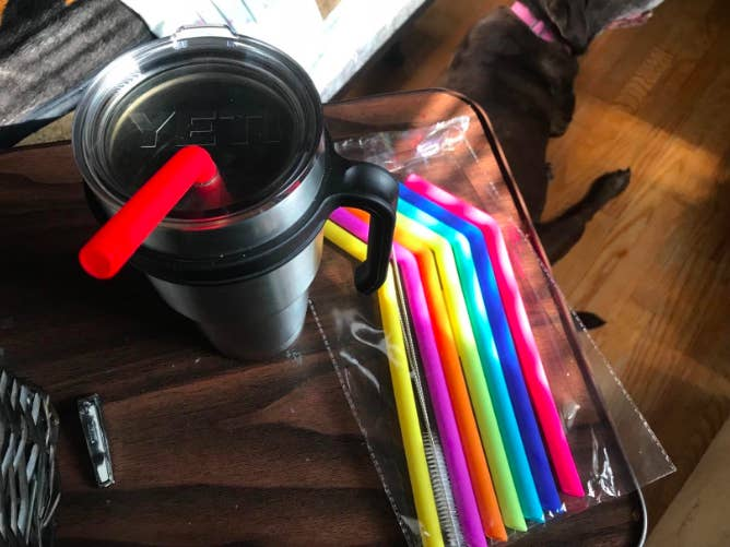 the brightly colored straws in a pack and in a Yeti