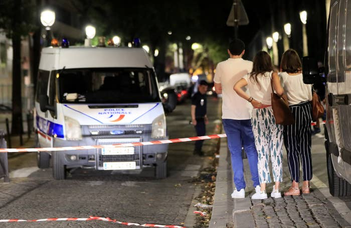 Police investigators work at the scene of a knife attack in downtown Paris that left seven people injured Sunday night.