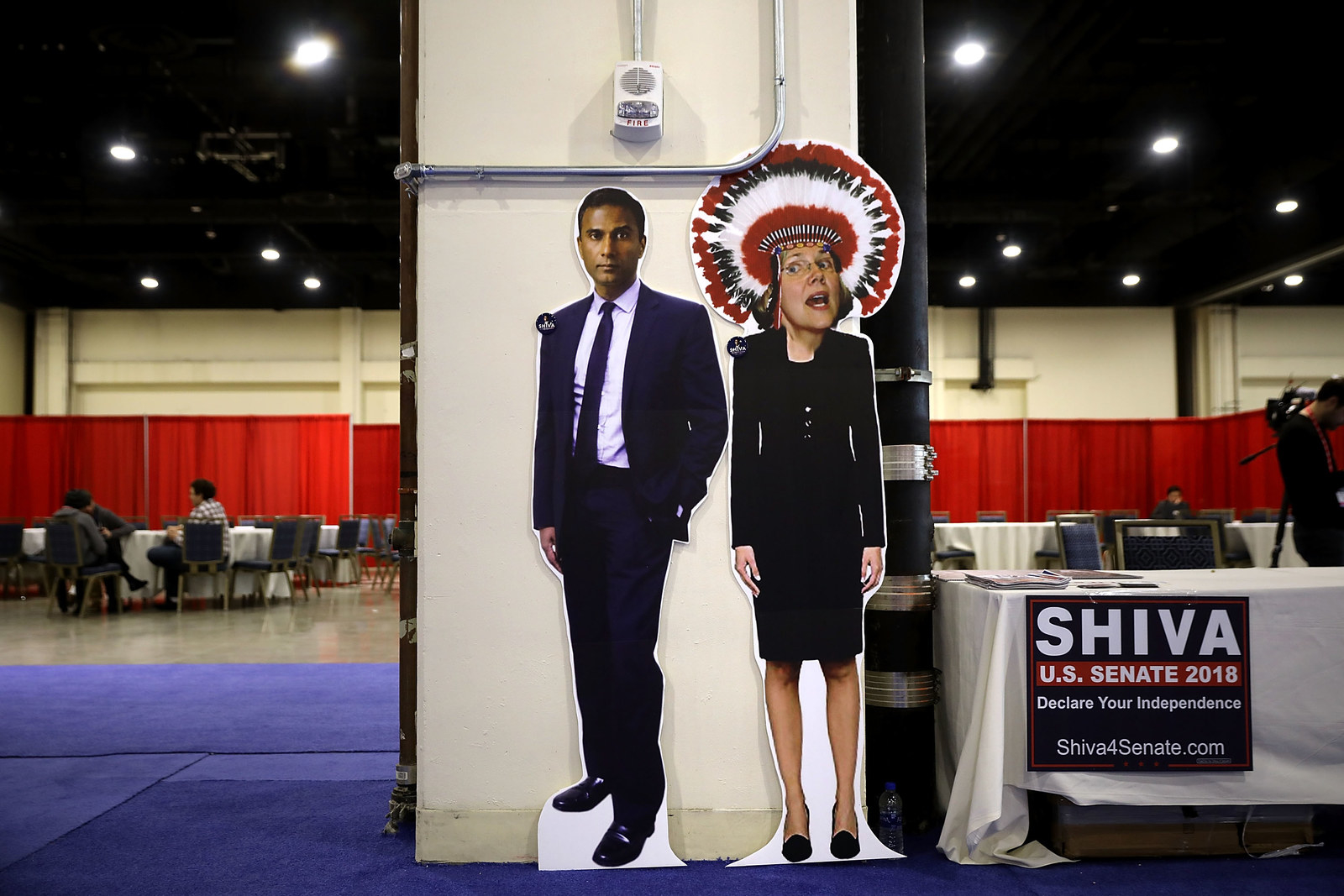 A booth in support of Shiva Ayyadurai, who is running against Sen. Elizabeth Warren, displays a photoshopped image of Warren wearing a Native American headdress inside the Conservative Political Action Conference Hub, Feb. 23, 2018 in National Harbor, Maryland.
