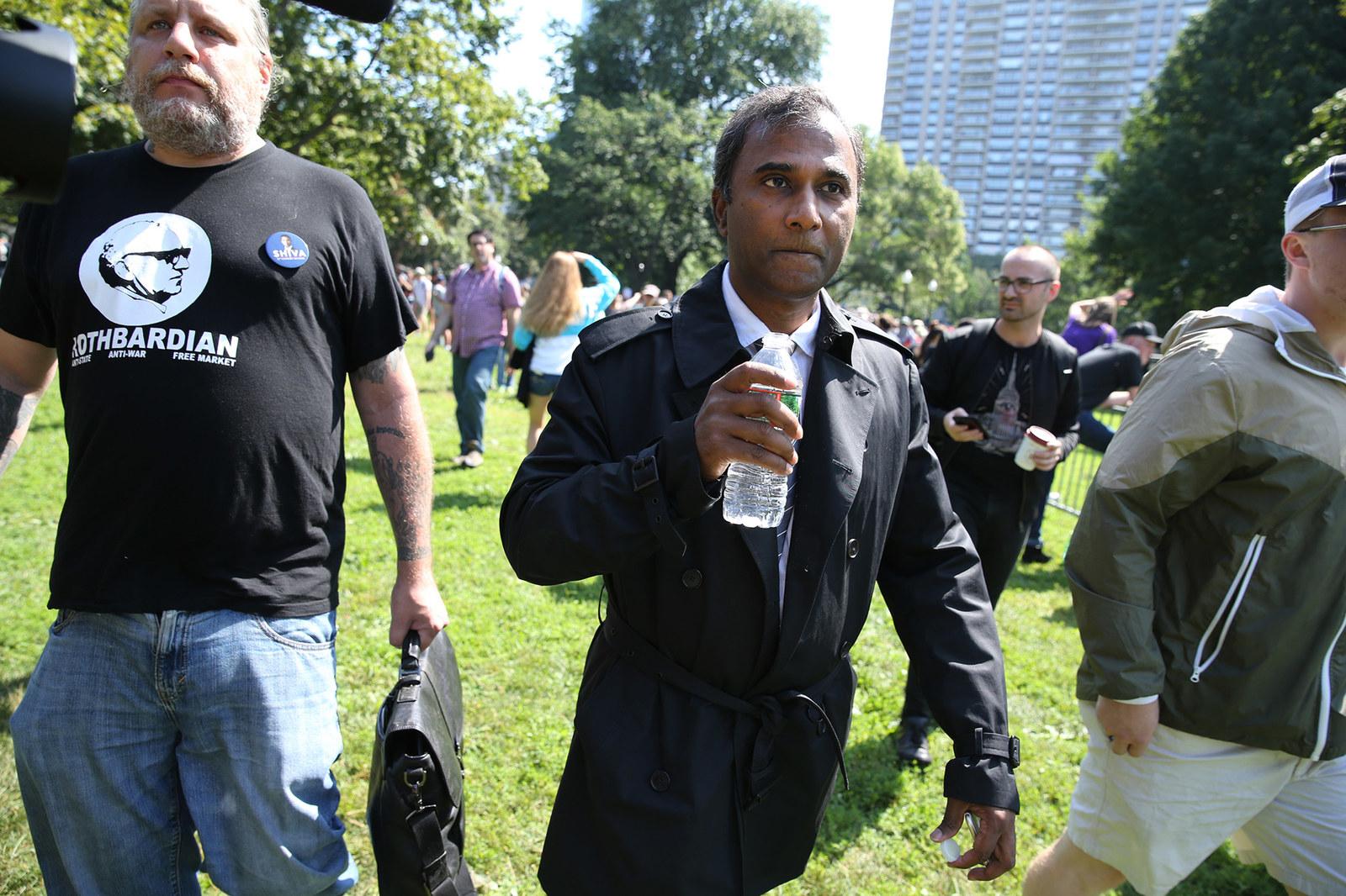 Shiva Ayyadurai (center) makes his way to the Boston Free Speech rally where he was scheduled to speak at the Boston Common, Aug. 19, 2017.