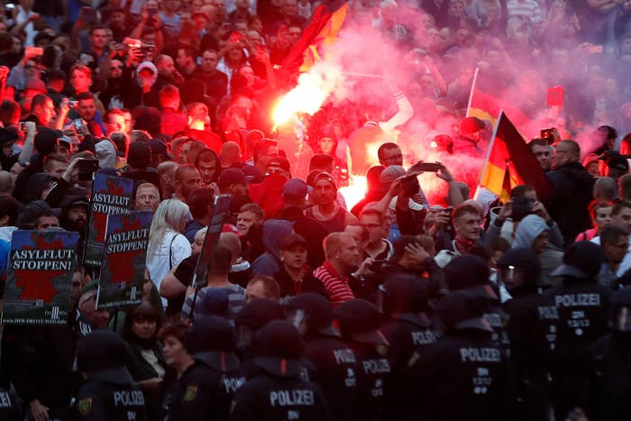 Demonstrators light flares during an anti-immigration protest in Chemnitz in August.
